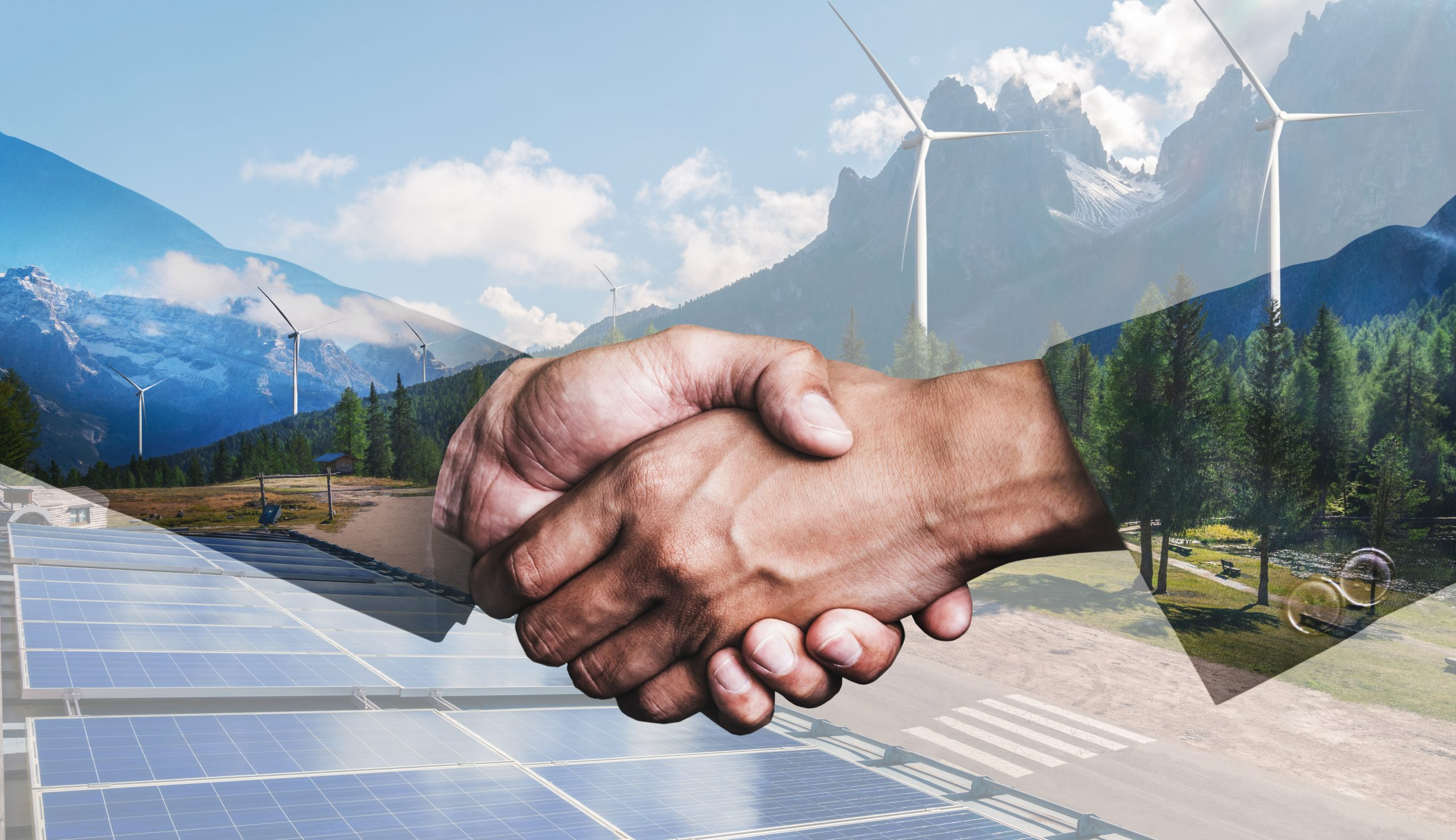 Double exposure graphic of business people handshake over wind turbine farm and green renewable energy worker interface